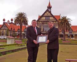 Warren Harford of the Agrodome is presented with a certificate of acknowledgment by Centennial Trust Chairman Lyall Thurston
